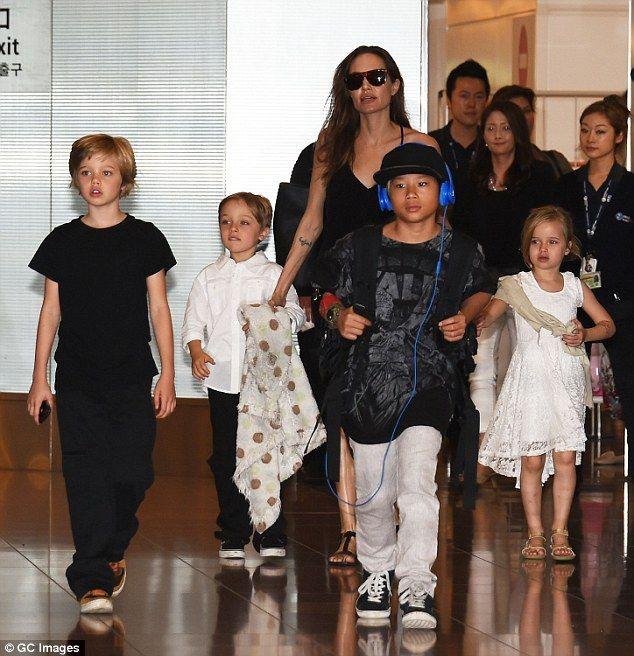 Happy family: The Tomb Raider star has three adopted children Maddox, Zahara and Pax, and ...