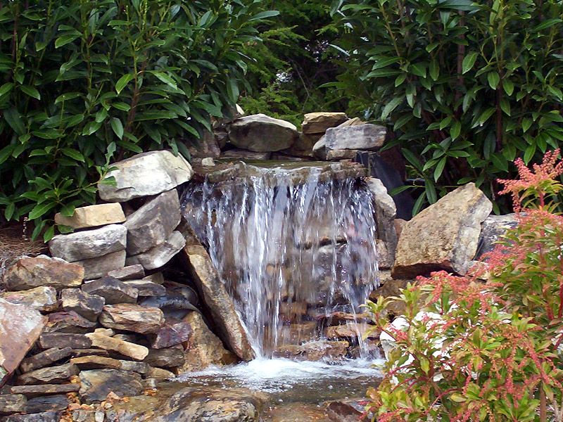 Diy garden waterfalls water features pond waterfall and for Pictures of backyard waterfalls
