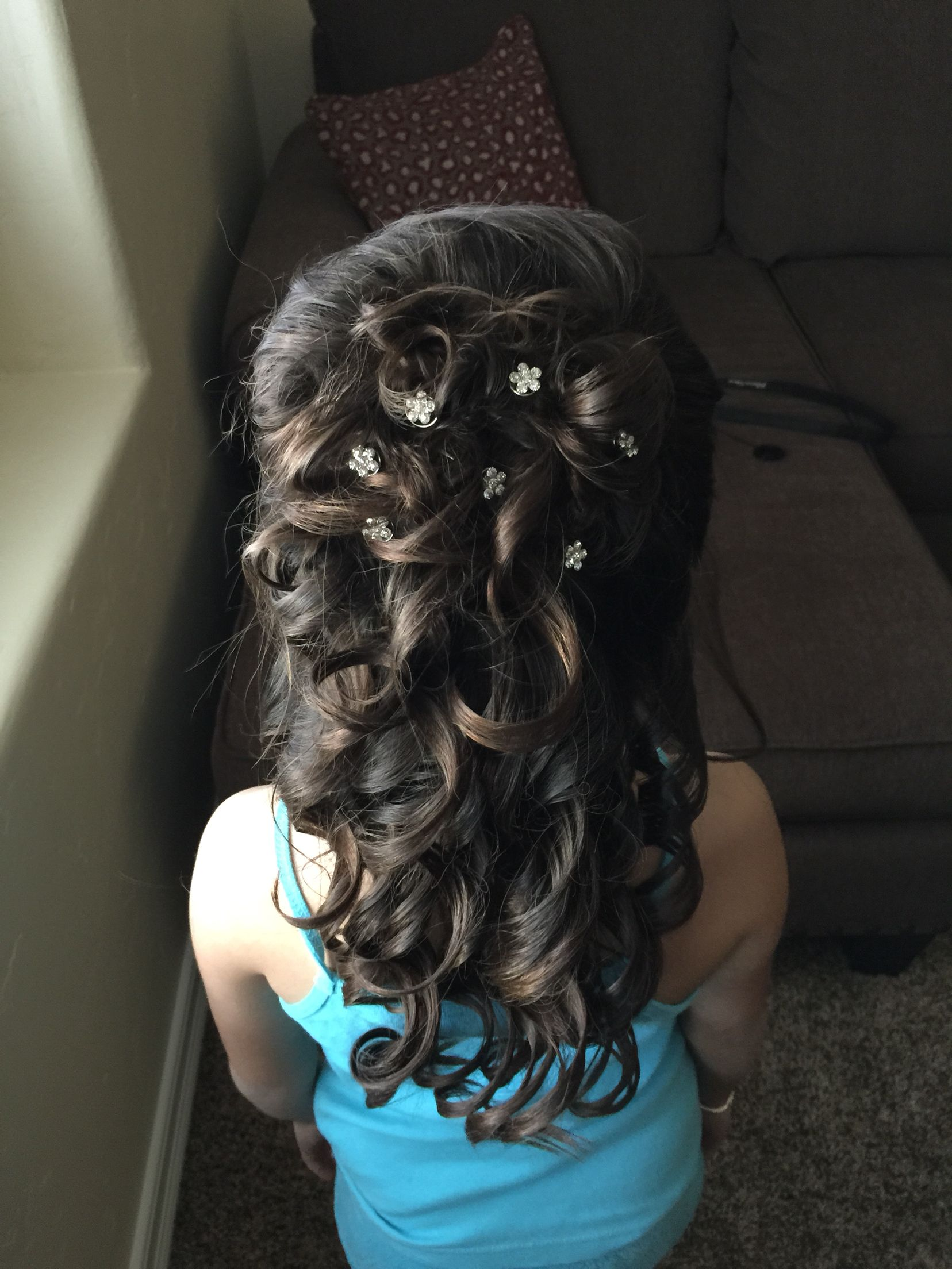 formal hairstyle. little girl . half up. curls . pretty