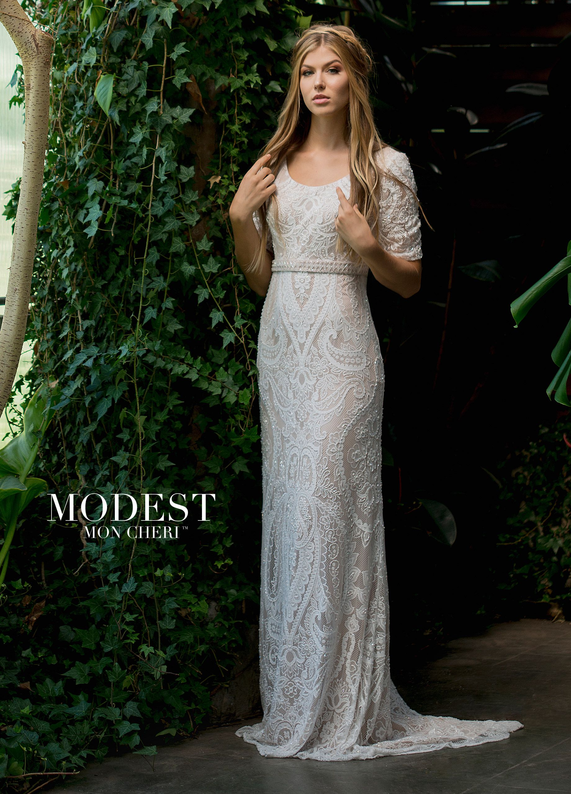 c99c3464c4c9 Modest Wedding Dresses TR11833 - Soft allover embroidered and beaded lace  sheath with elbow-length sleeves, scoop neckline, center back hidden  zipper, ...