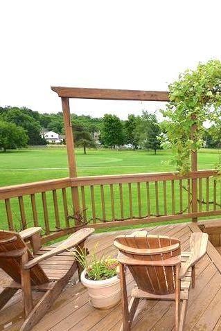 Enjoy a golf course view of lush green landscaping   1113 FRANKLIN CT SW, LEESBURG, VA 20175   atokaproperties.com