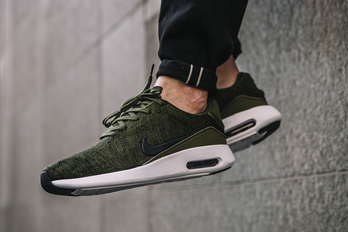 213e547249aa On-feet images of the Nike Air Max Modern Flyknit in the Rough Green  colorway.
