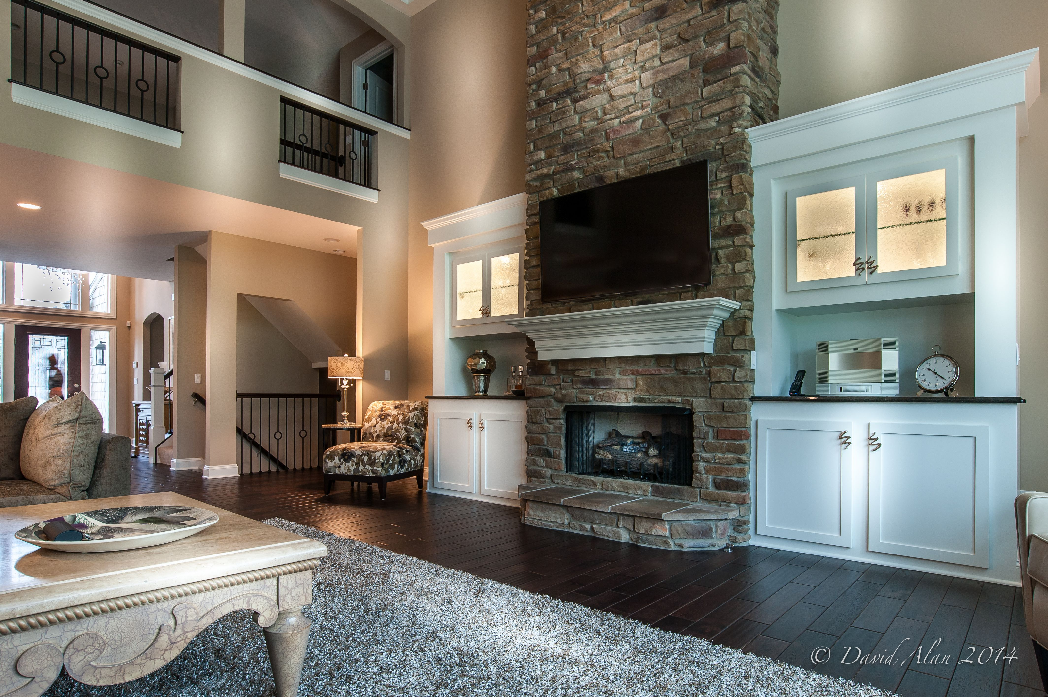 stone fireplace and built ins two story great room built and