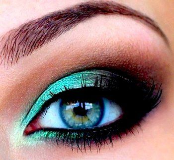 Beautiful peacock eye shadow.  Use  turquoise shadow wet all over the lid and under it.  Then use pencil liner on the inner lids and feather to the outside corner.  Use a good brush to blend it all into a vee.  Good mascara finishes the sensational eye.