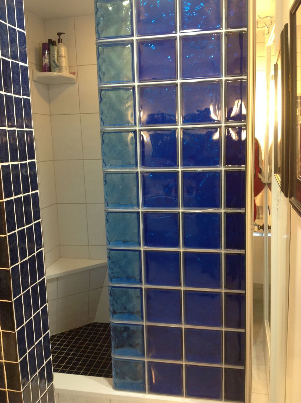how to use a colored glass block partition and shower walls to dress up a condo remodeling project