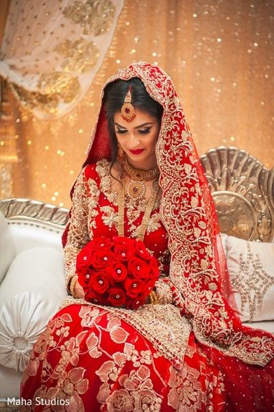 fbddeb949b Indian bride holding her bouquet at wedding reception http://www. maharaniweddings. Visit. January 2019