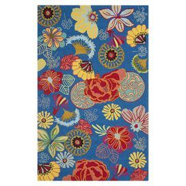 Anchor your patio seating group or define space in the den with this artfully hand-hooked indoor/outdoor rug, showcasing a contemporary floral motif for eye-catching appeal.