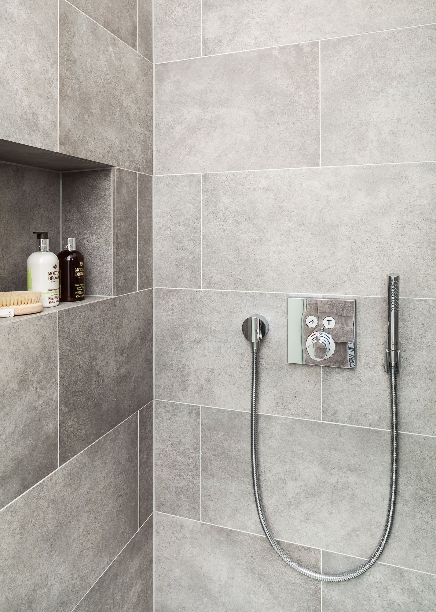 Modern tiled shower cubical. Featuring recessed shelf and modern ...