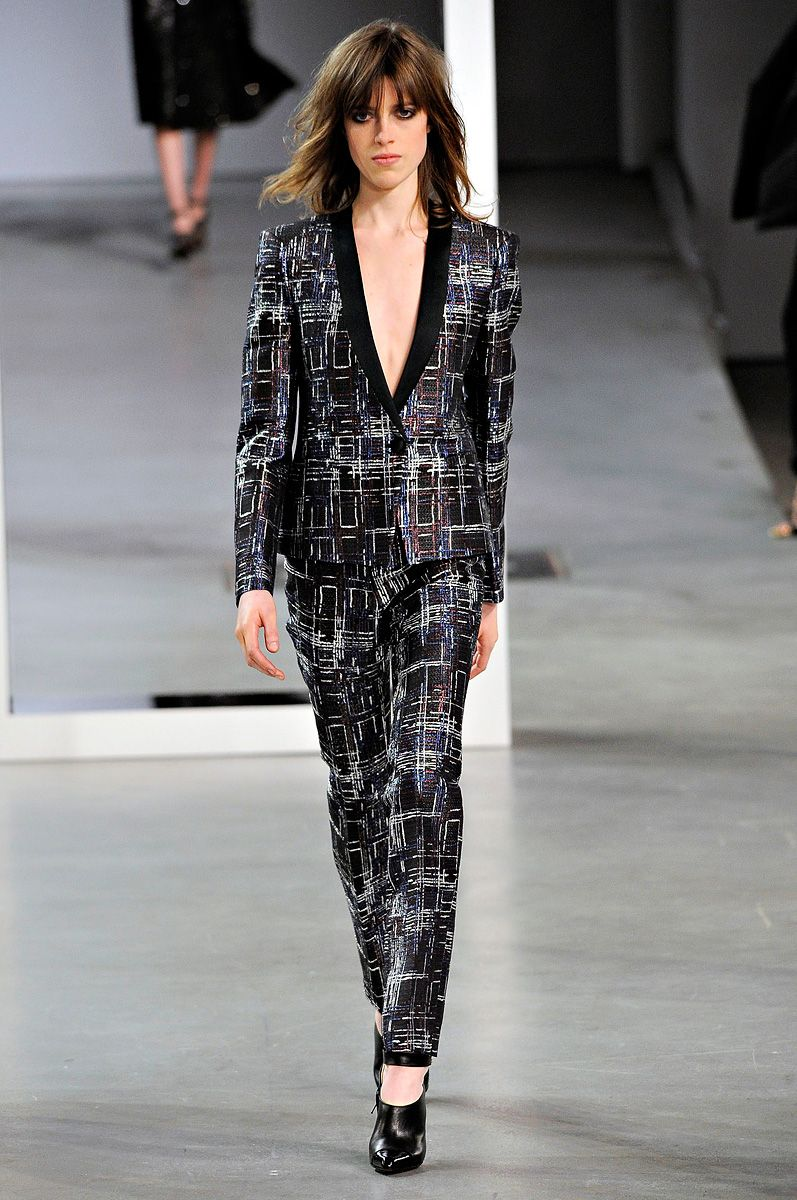 Derek Lam. One of my favorite pant suits of the week. I love prints. This indutrial print combined with the sleekness of the suit make the look slightly androgynous and very modern.