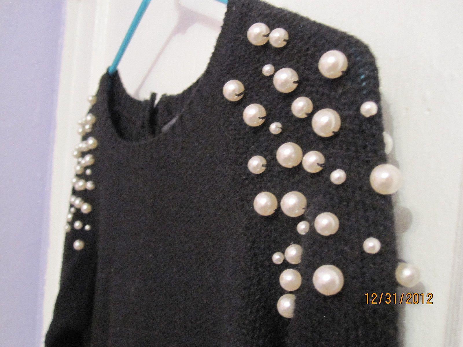 Pearl shoulder sweater