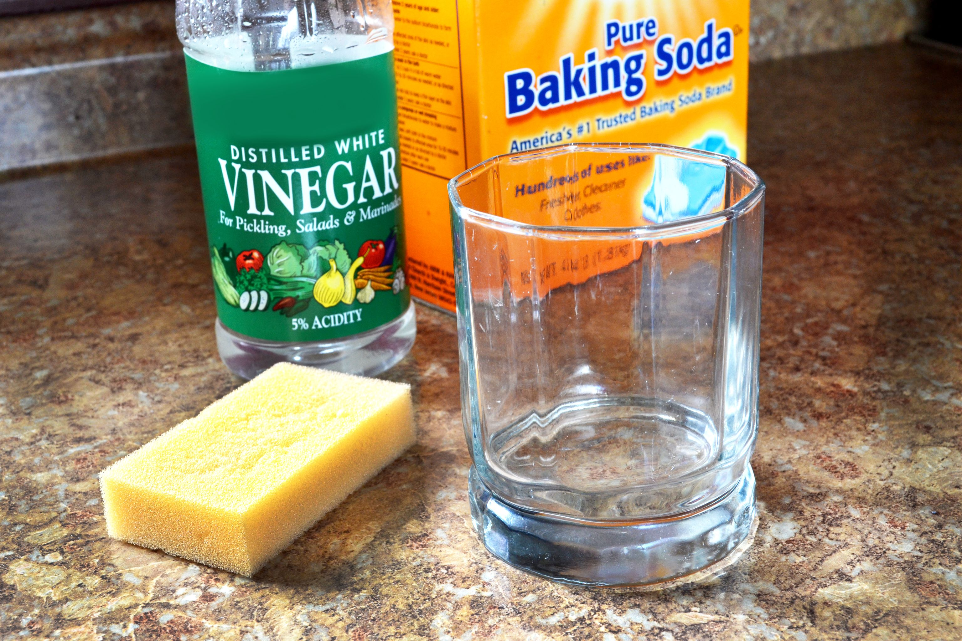 How To Clean Calcium Deposits Off Glass Hunker Cleaning Clean Dishwasher Cleaning Hacks