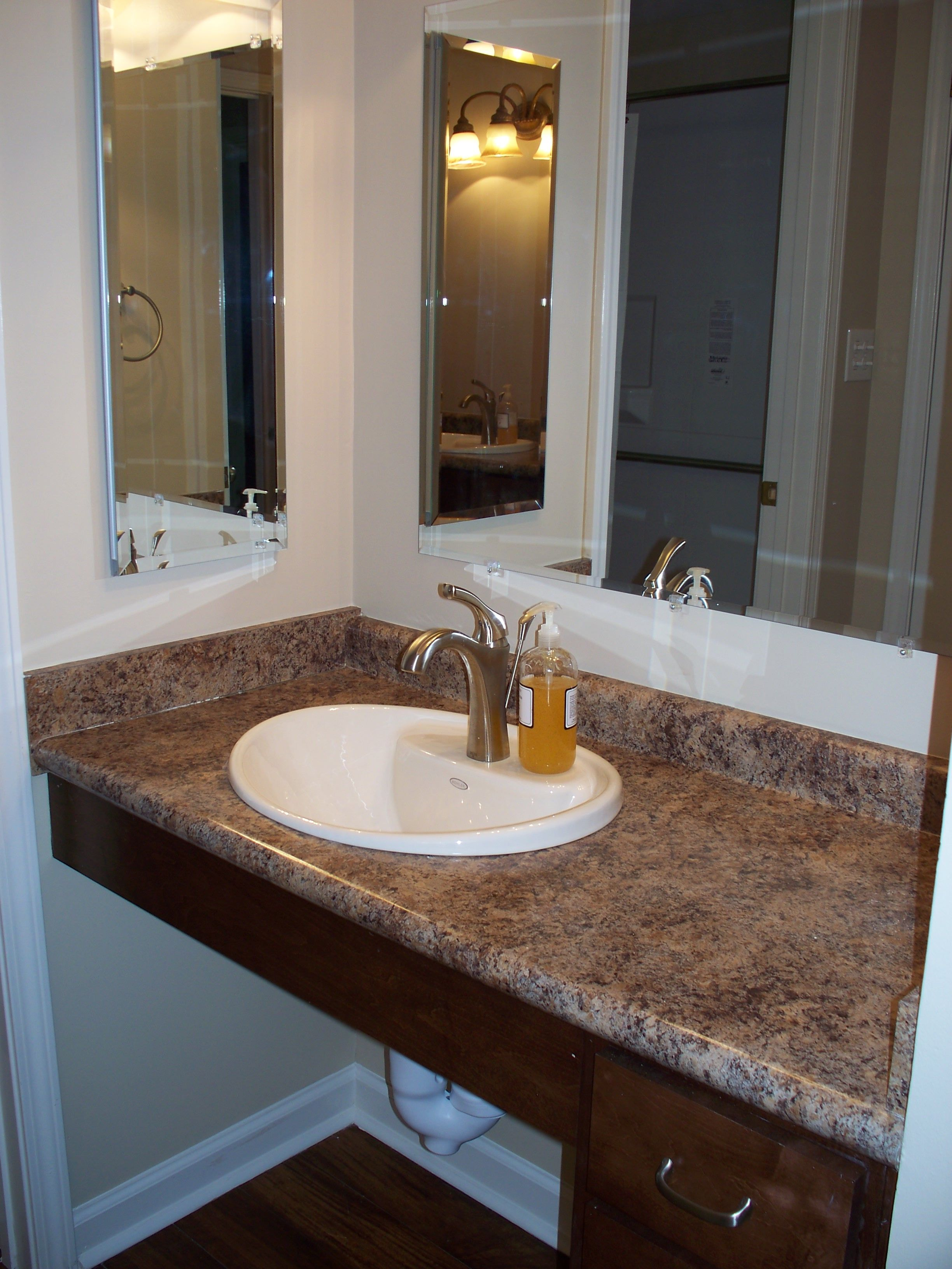 Example of a wheelchair accessible vanity. Note the lever handle ...