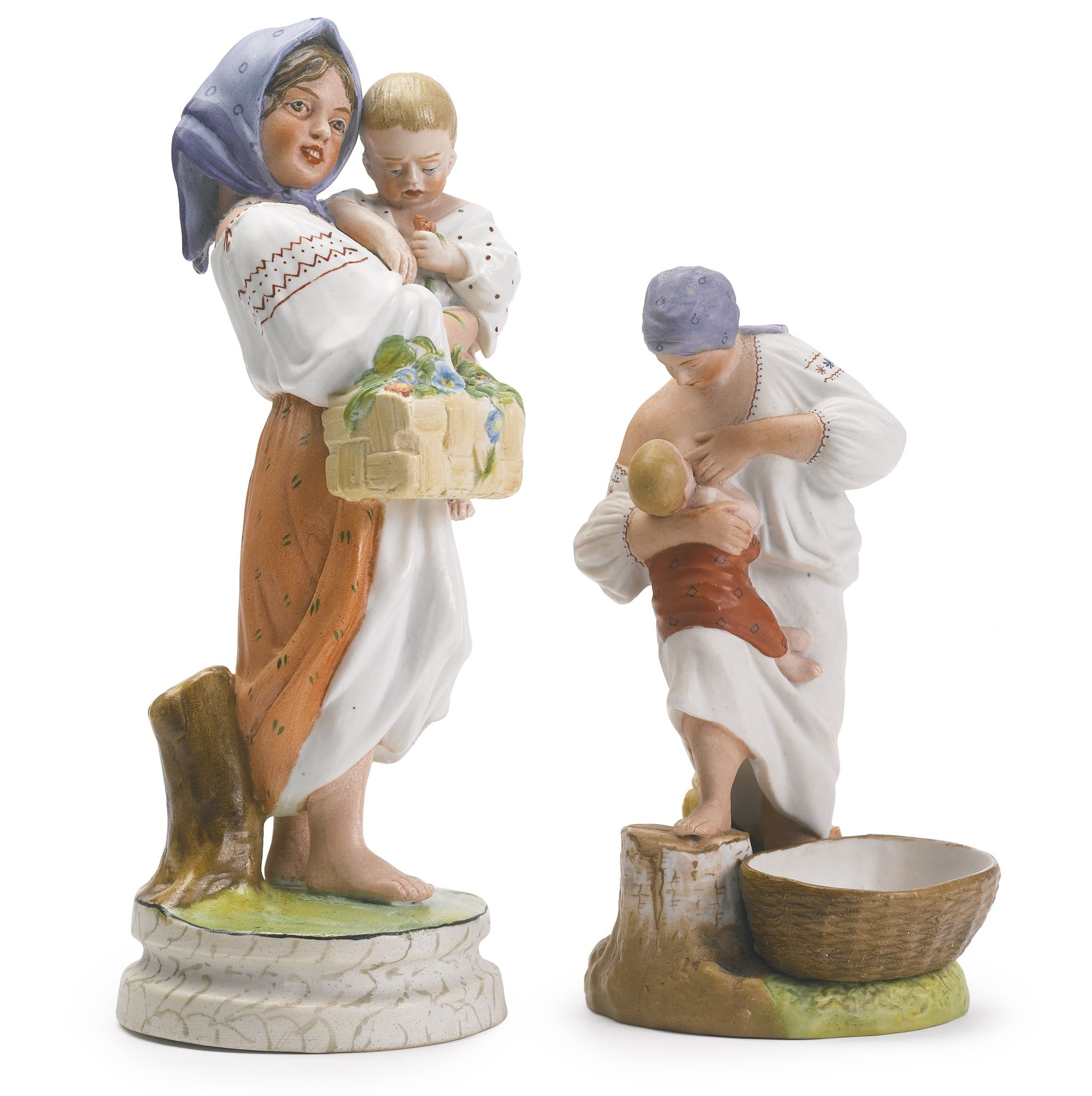 Two Russian porcelain figures, Gardner Porcelain Manufactory, Verbilki, circa 1870s, the first depicting a peasant girl holding an infant and a basket of flowers, the second depicting a peasant woman pausing from her work to feed her child, both with impressed factory marks and production numbers