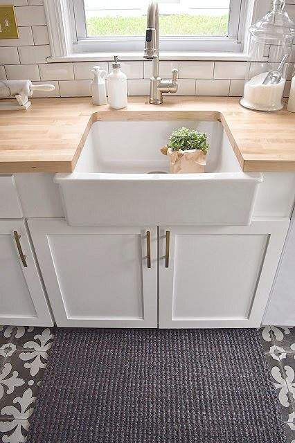 White Kitchen Remodel With Patterned Tile And Butcher Block Counter Tops. Ikea  Farm Sink.
