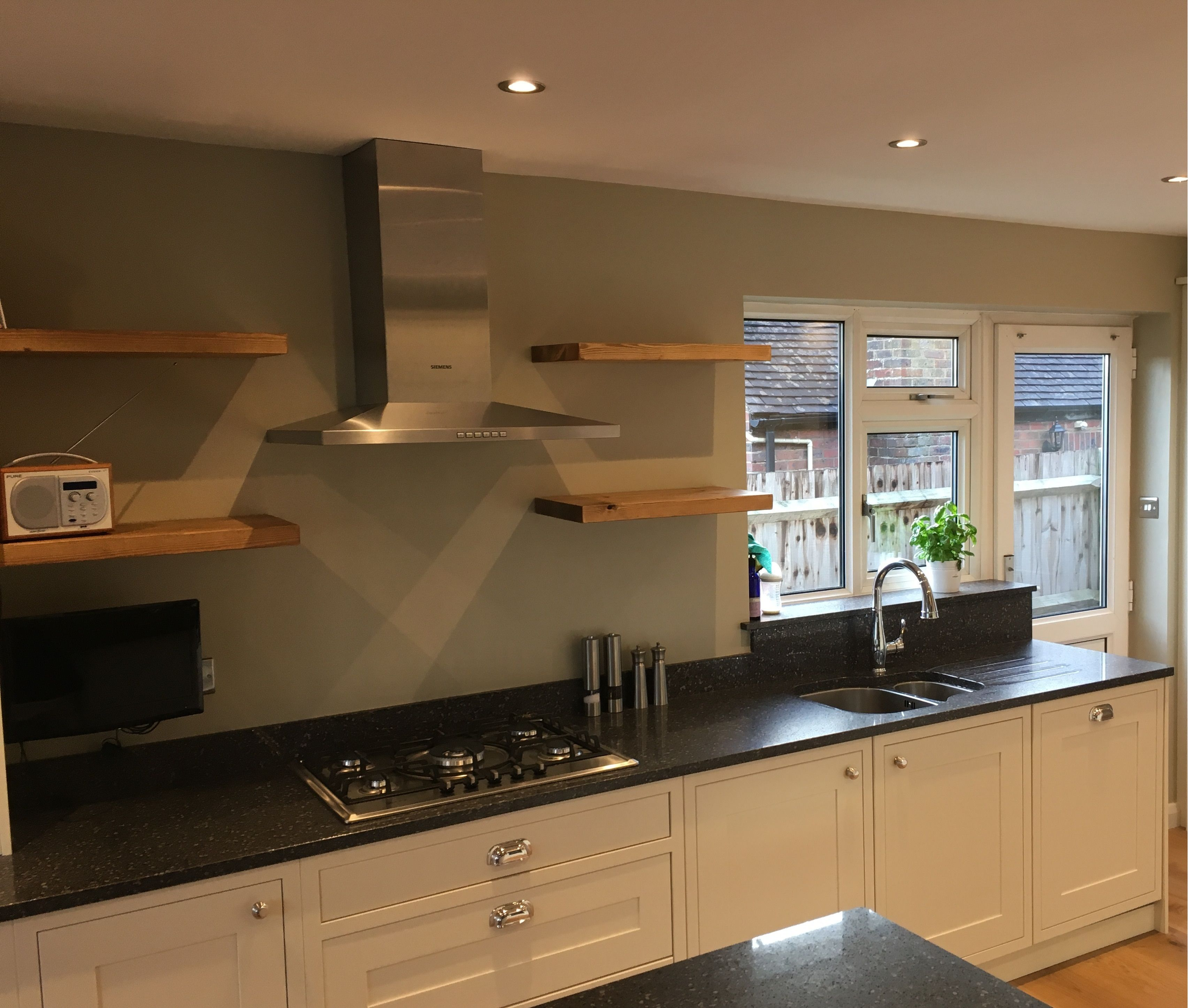 Separate kitchen, dining and living room converted into a