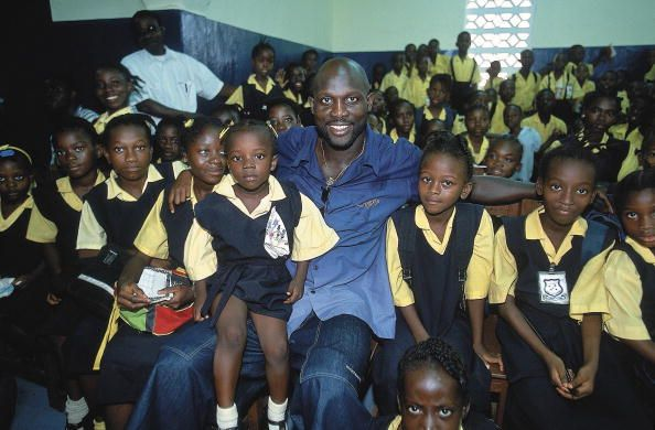 Casual portrait of George Weah with school children Monrovia Liberia 2/24/2001