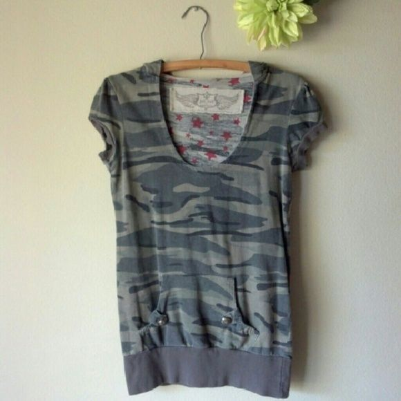 "Camo Pullover Top Short sleeve camo top with hoodie. Reposh. Has eyelets for a string on the hoodie, but the string is missing. Pass through pocket on the front with two cute buttons! Goes great with jeans or shorts!! No flaws, but is preloved and the color is fading. I wore a tank top underneath.  Length approx 27"", waist band unstretched approx 16"", across chest approx 18"". 100% cotton.  Price FIRM unless bundled. Sorry, no modeling. No trades. Jet Set Tops"