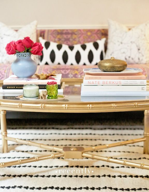 Splatter paint pillows, ikat pillow, moroccan rug, faux bamboo coffee table!