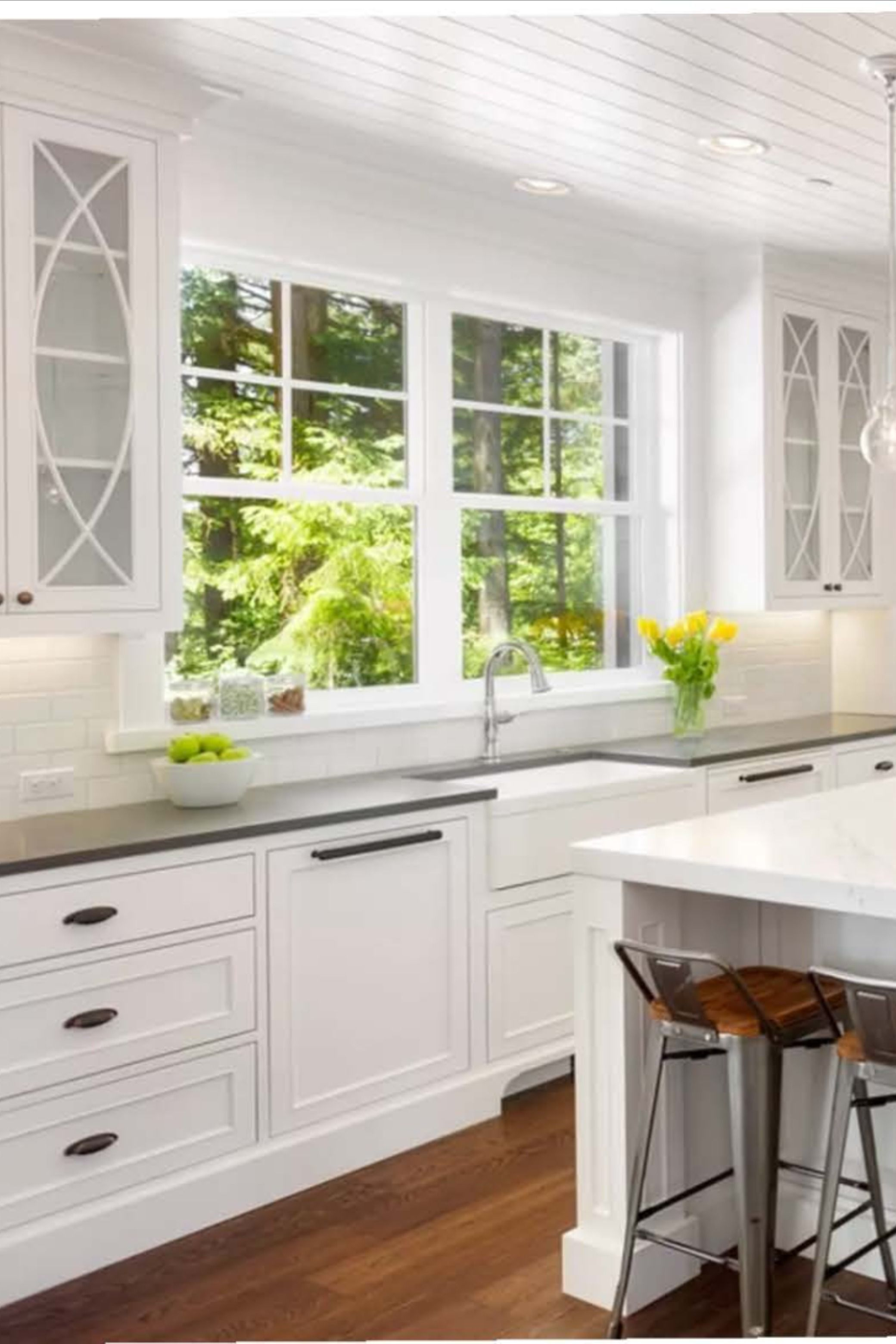 Your minimalist dreams come true! ☺️ This white kitchen interior design highlighted with darker accents really opens up this space 🤍🌳 #whitekitchen #minimalisthome #minimalistdecor . . . . . Find ideas and inspiration for your kitchen decor with Catani Cabinets on Pinterest and IG! 💭📌 Click the link in below to learn more about our kitchen remodel services for the Minneapolis and St. Paul areas! 🚪⚒️