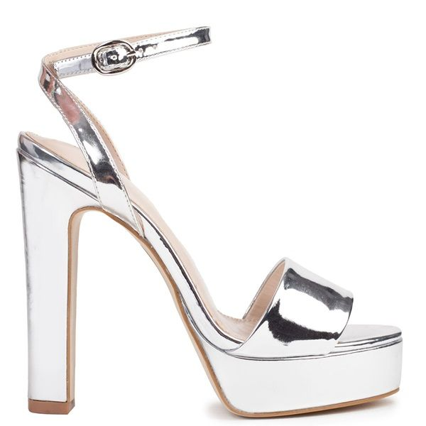 610eac74b6df Silver metallic high-heel sandal with platform. Features with block heel  and fastens with adjustable ankle strap.