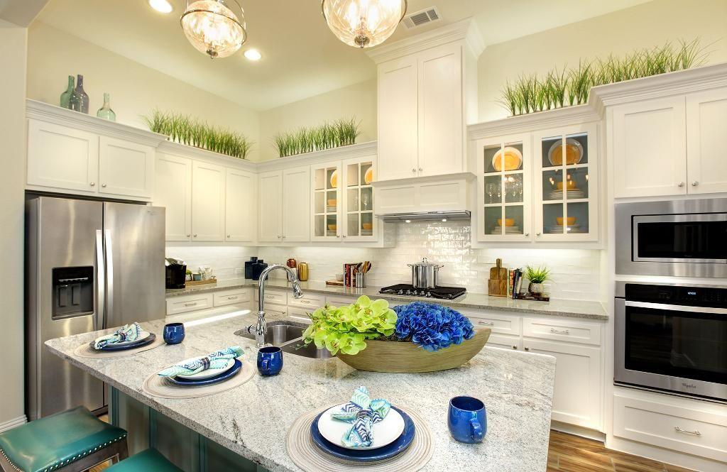 Kitchen with white cabinets; The Rosella floor plan, Drees ...