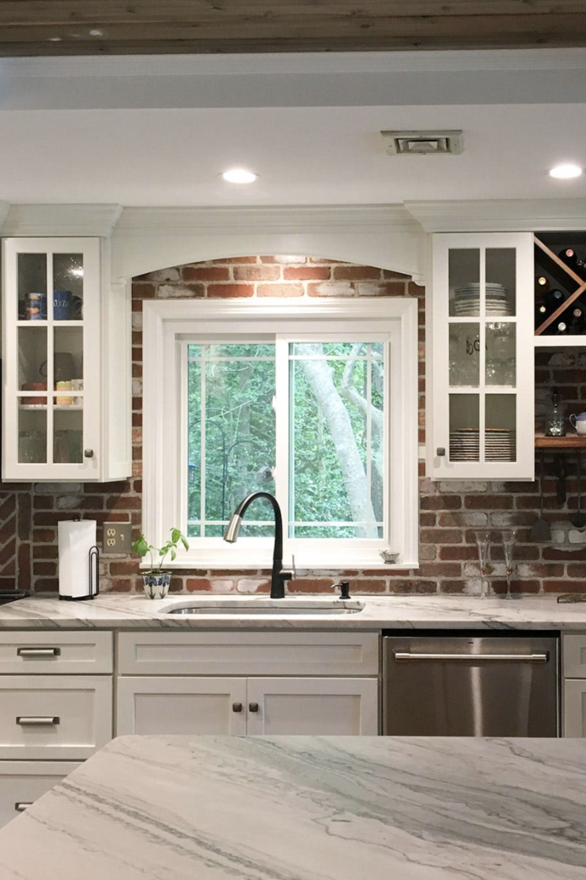 Mixed To Match In 2020 Brick Backsplash White Cabinets Marble Countertops