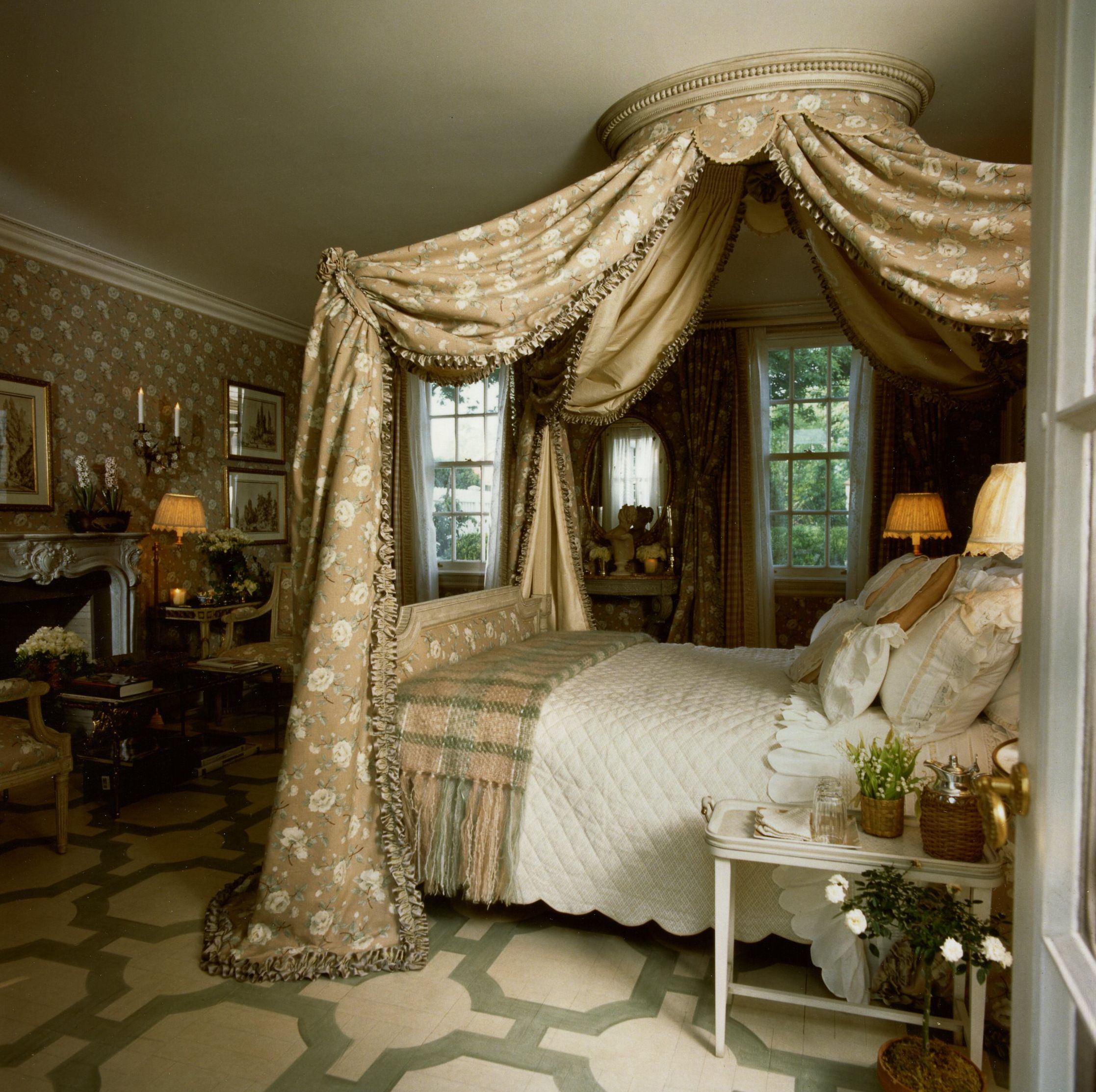 Bedroom with window over bed  love the tiester over the bed very elegant the wallpaper and