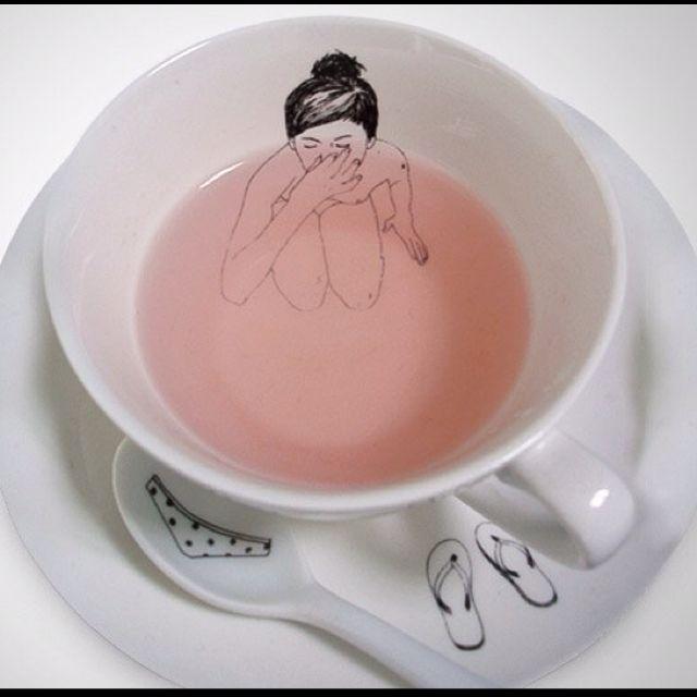 Girl bathing in a tea cup