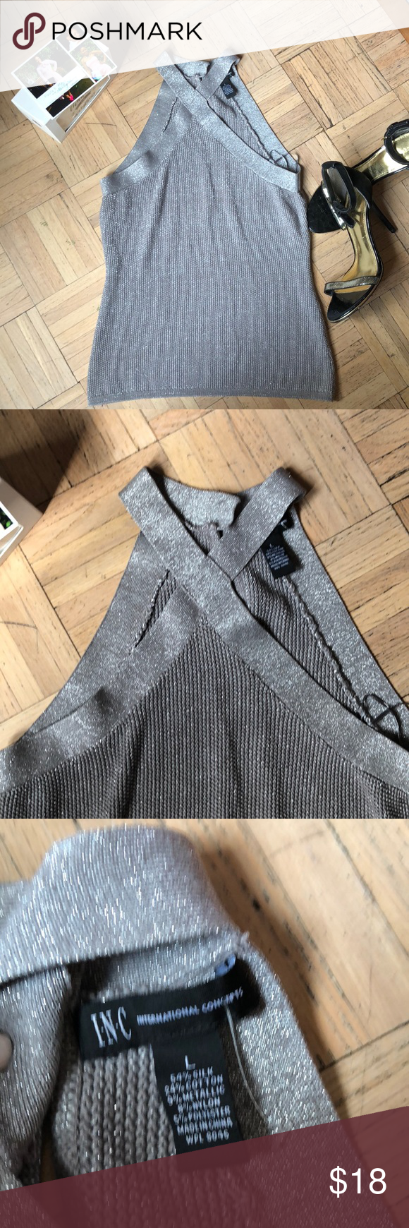 Sleeveless Halter Silver Sweater w/ high neck Top has a criss cross feature at the neck and button closure in the back. My items are lovingly worn & taken care of; all in good condition. Follow me on Facebook @paulafmoreno or Instagram @HarlemQT: tag me so I can show #poshlove! Buy this set or #Bundle 📦 anything in my closet for 10% 💵off total 💰purchase🛍. Send an offer & let's make a deal. INC International Concepts Tops