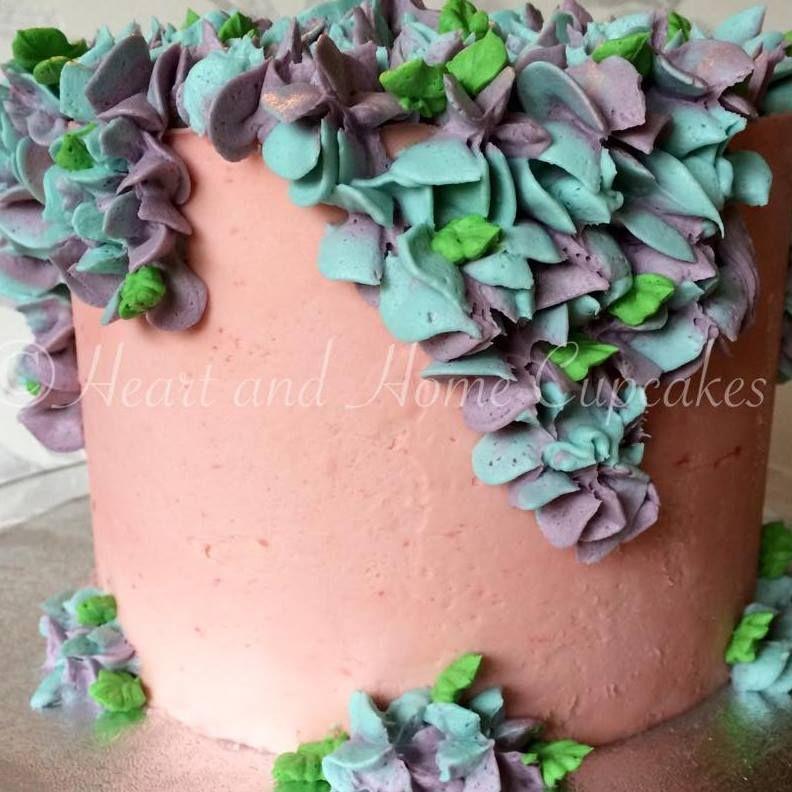 Raspberry and vanilla birthday cake with buttercream hydrangea.