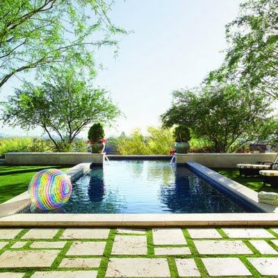 grass around pool is divine. love the travertine tiles and subtle