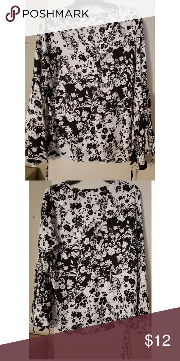 60b84e2232 Black-white Floral Print Blouse V-neck. Flared sleeves with tie strings. Gently  used. Great condition. Adrianna Papell Tops Blouses