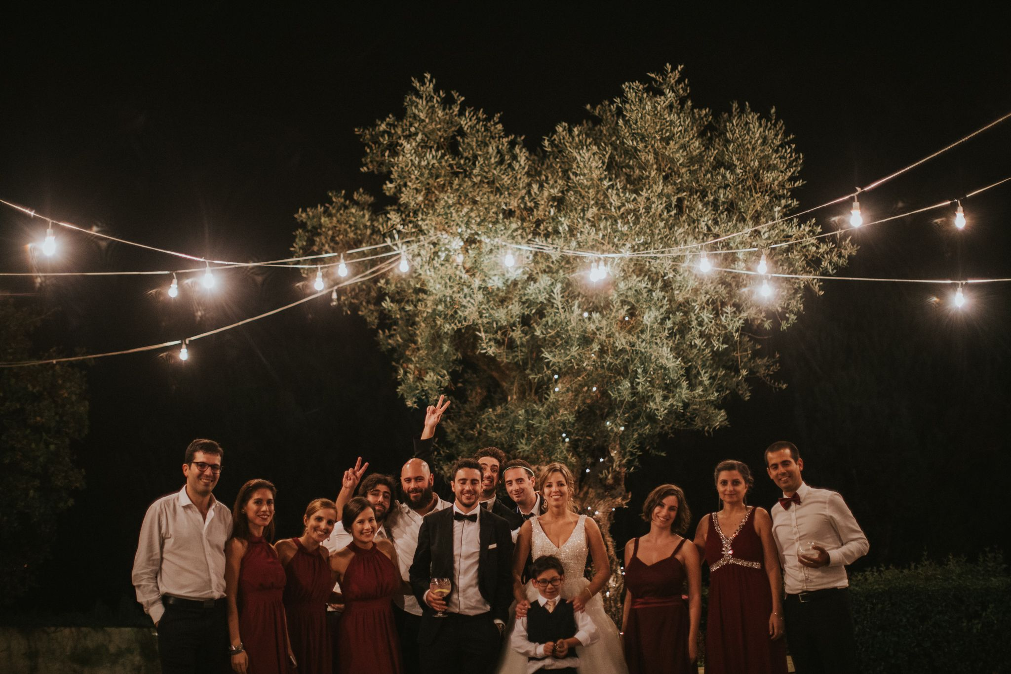 Best wedding dresses for travel  Bridesmaids  Best man  burgundy dress  burgundy bow tie  lights