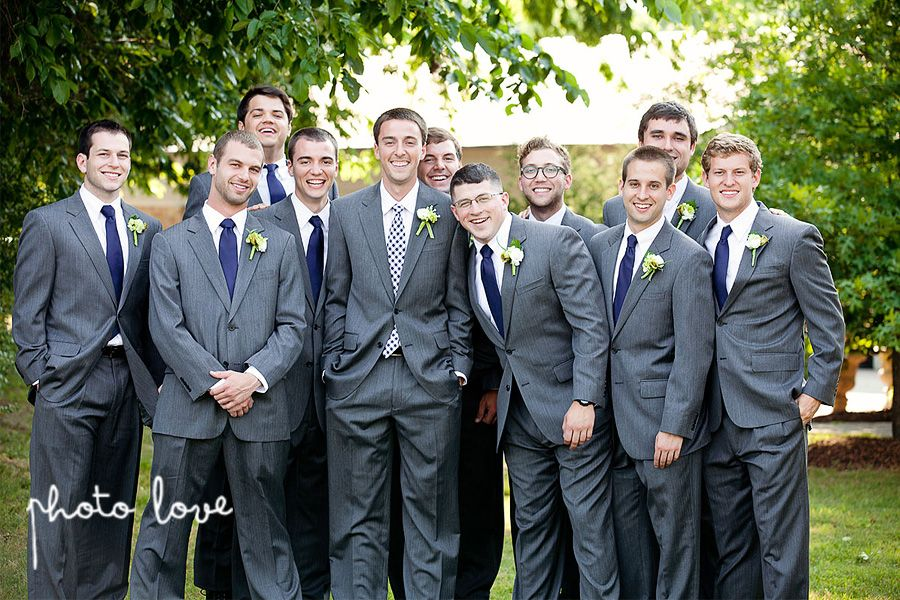 Groomsmen in grey suits with navy ties. Yellow, coral, and blue ...