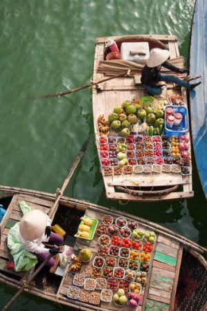 Fruit sellers at Vietnam's Halong Bay.