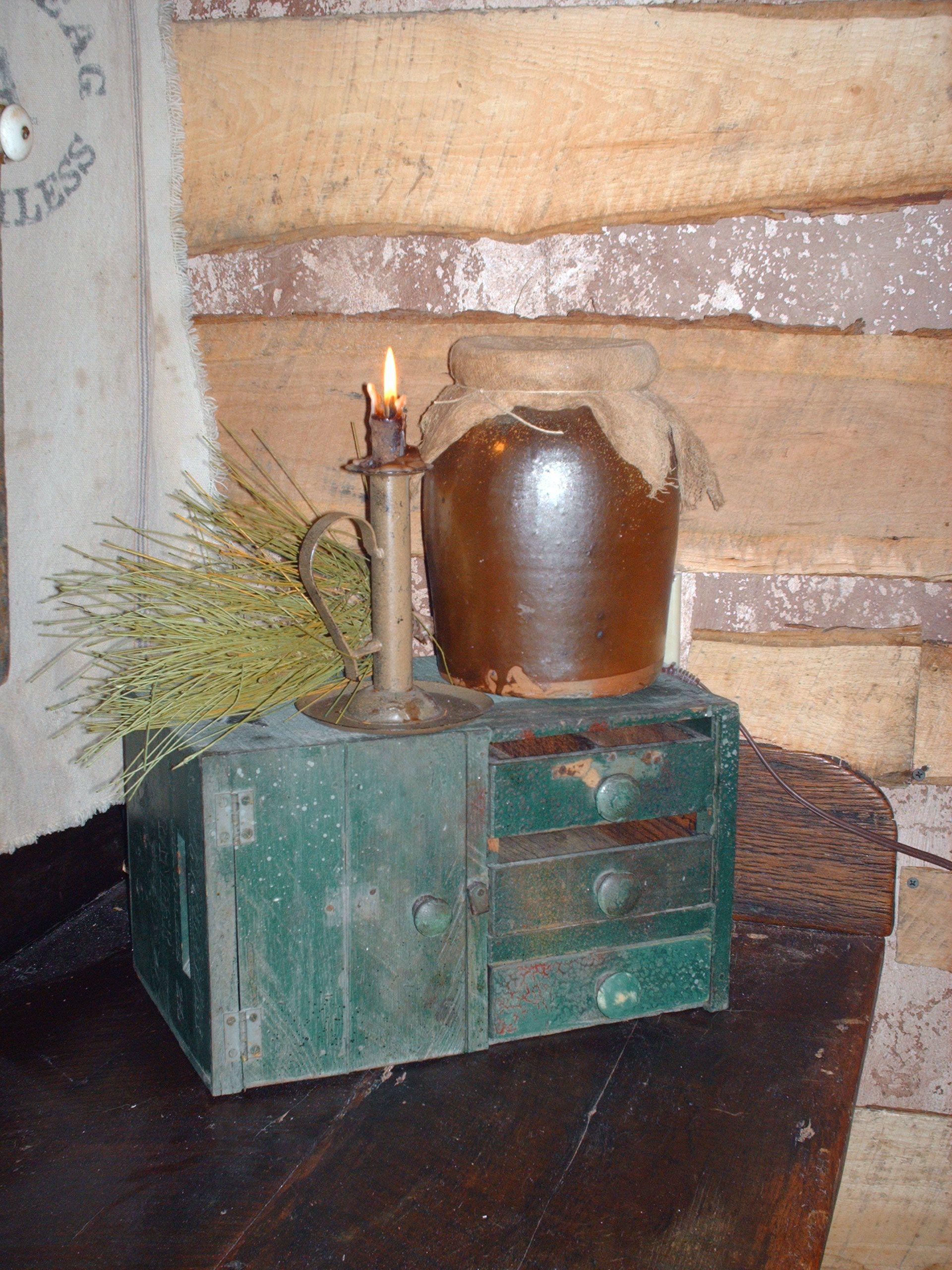 Log Cabin Prims...counter cupboard, old crock & candleholder.