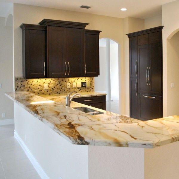 Contemporary kitchen featuring Roma imperiale Quartzite countertops ...