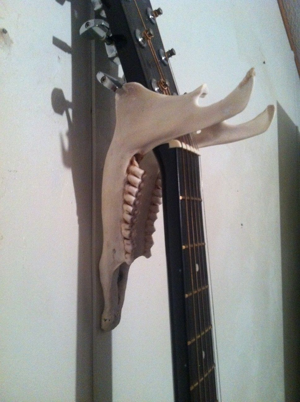 Homemade Guitar Wall Hanger Made Out Of A White Tailed