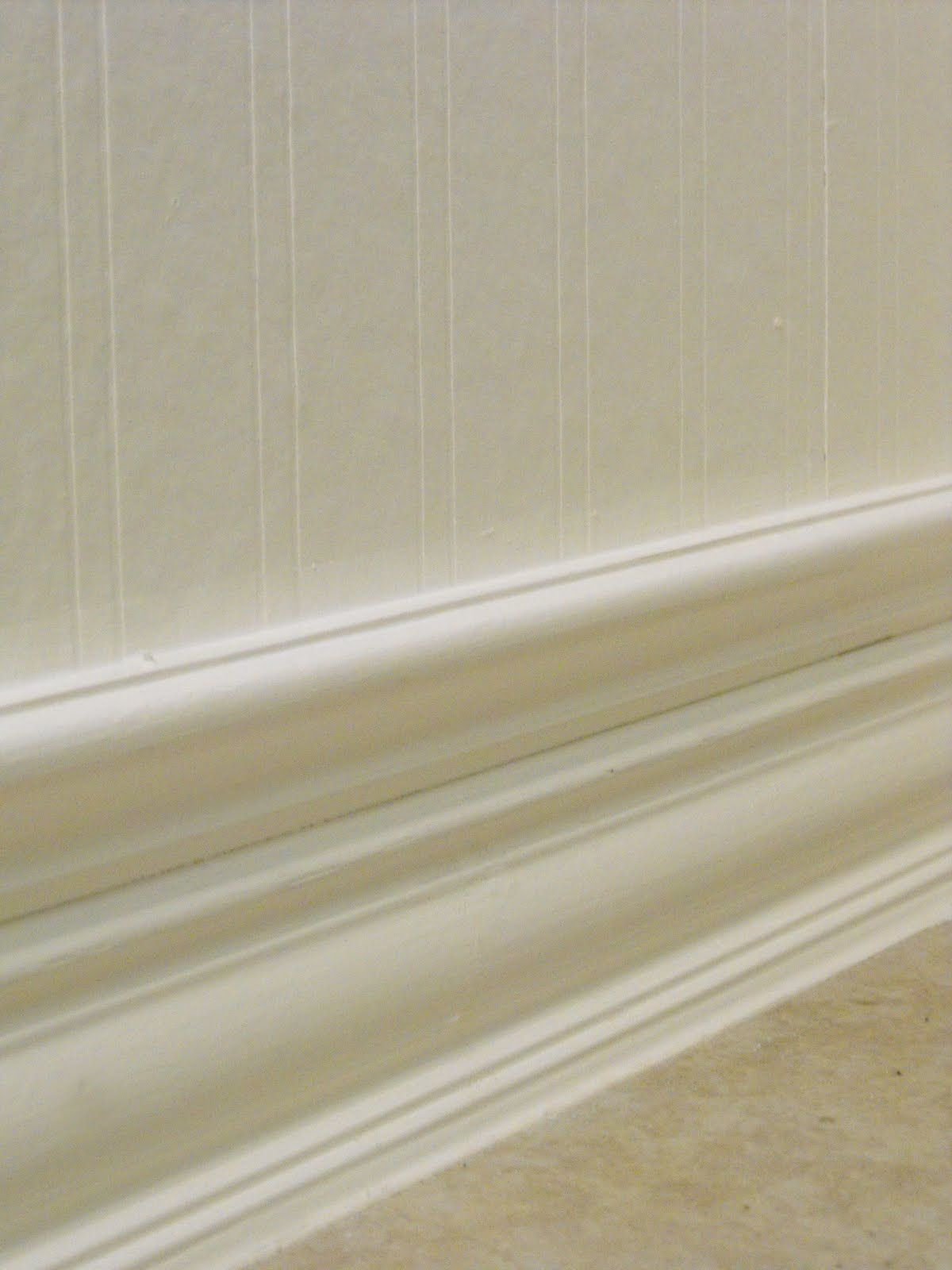 Beadboard wall papers and taller baseboard by adding a trim to the make small baseboards bigger by adding additional molding on top caulk trick use painters tape to keep line straight peel off before dry doublecrazyfo Image collections