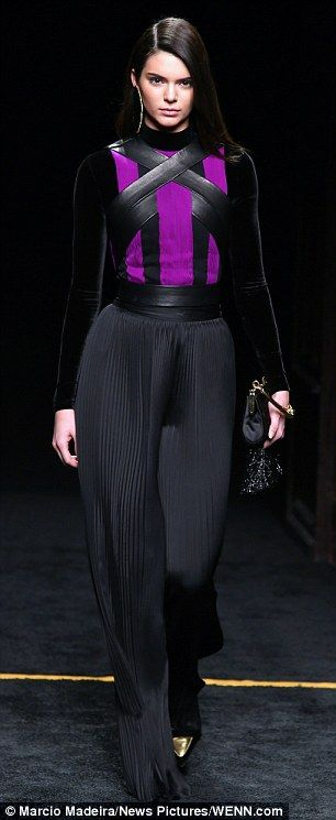 Kendall Jenner modelled looks for H&M and Balmain (pictured) during Paris Fashion Week