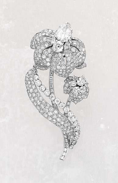 Cartier, A Diamond Brooch, circa 1935 Designed as a pair of peony flowers decorated with pave-set diamonds, centrally enhanced with a circular-cut diamond cluster pistil, the larger flower embelished with a single pear-shaped diamond, mounted in platinum