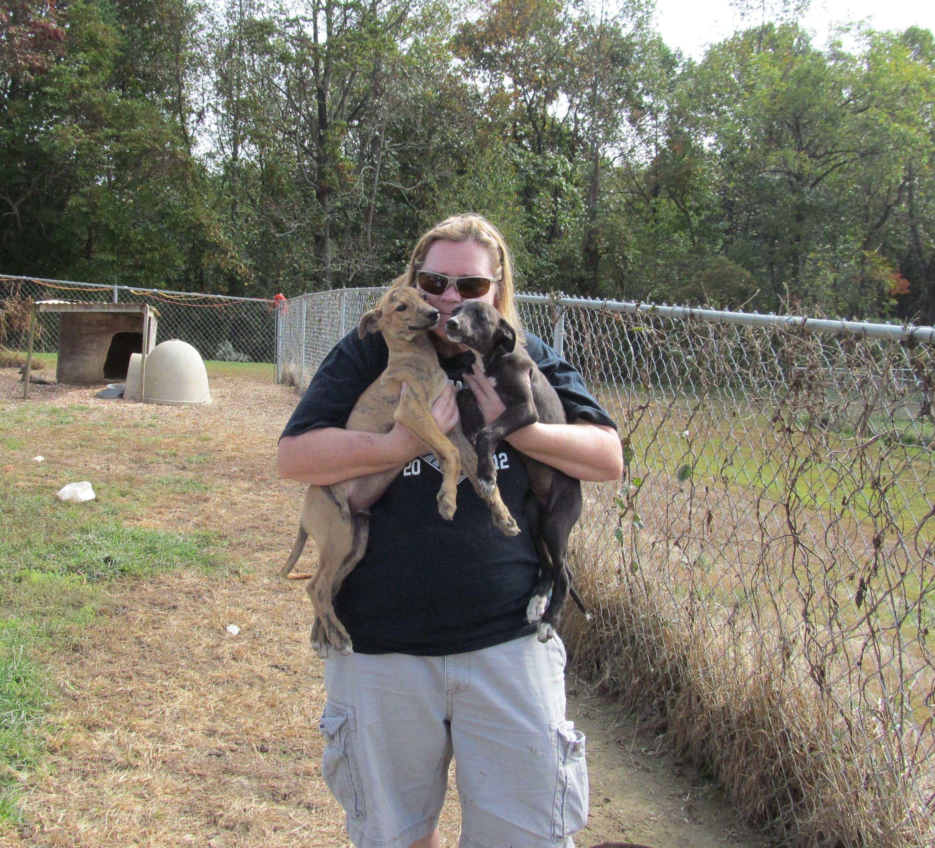 Debbie hugging some West Virginia puppies!