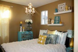 aqua, yellow, white bedroom with chandelier