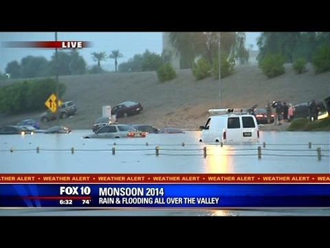 WATCH: Flooding on I-10, cars stuck underwater - YouTube