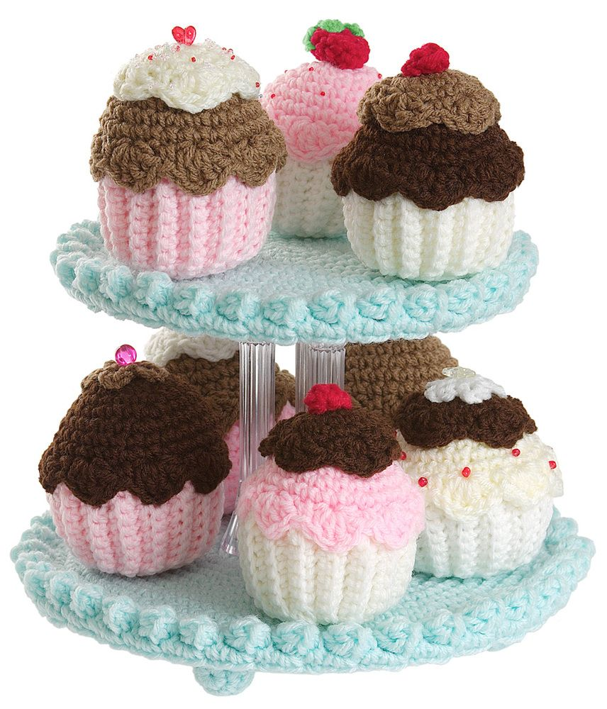"""Have fun crocheting this collection of fanciful frosted cupcakes! Tiered display stand is perfect for displaying all your small crocheted desserts and treats.SizeEach cupcake is 3 1/2"""" to 4"""" high"""