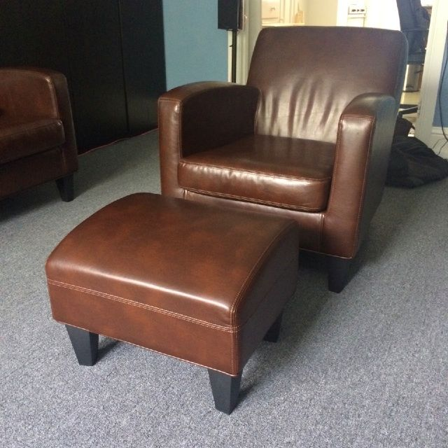 IKEA Jappling dark brown leather sofa chair and footstool