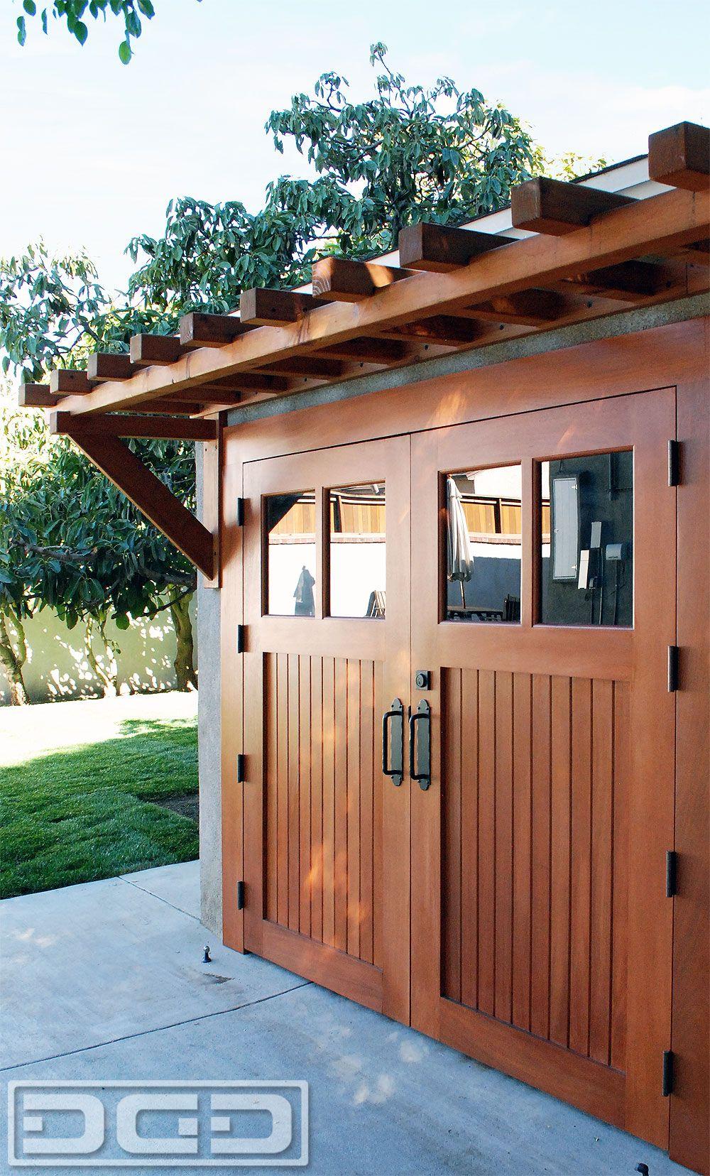 Trellis over garage door - Adding A Pergola Helps Dress Up A Garage Door Entry And Adds An Elegant Canopy Over Your Garage Door Trellises Support Vine Growth On Either Sid