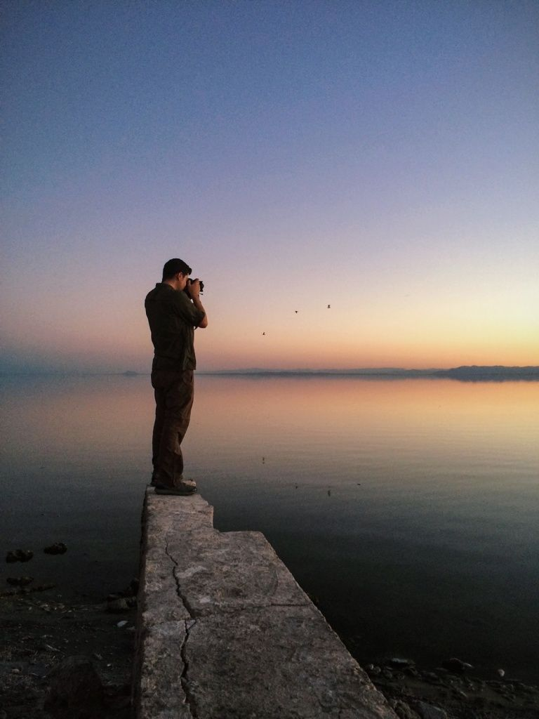 #sunset #man #lake #water #reflection