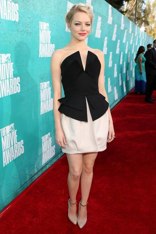 Emma Stone at the MTV Movie Awards wearing Martin Grant top and skirt, Brian Atwood heels