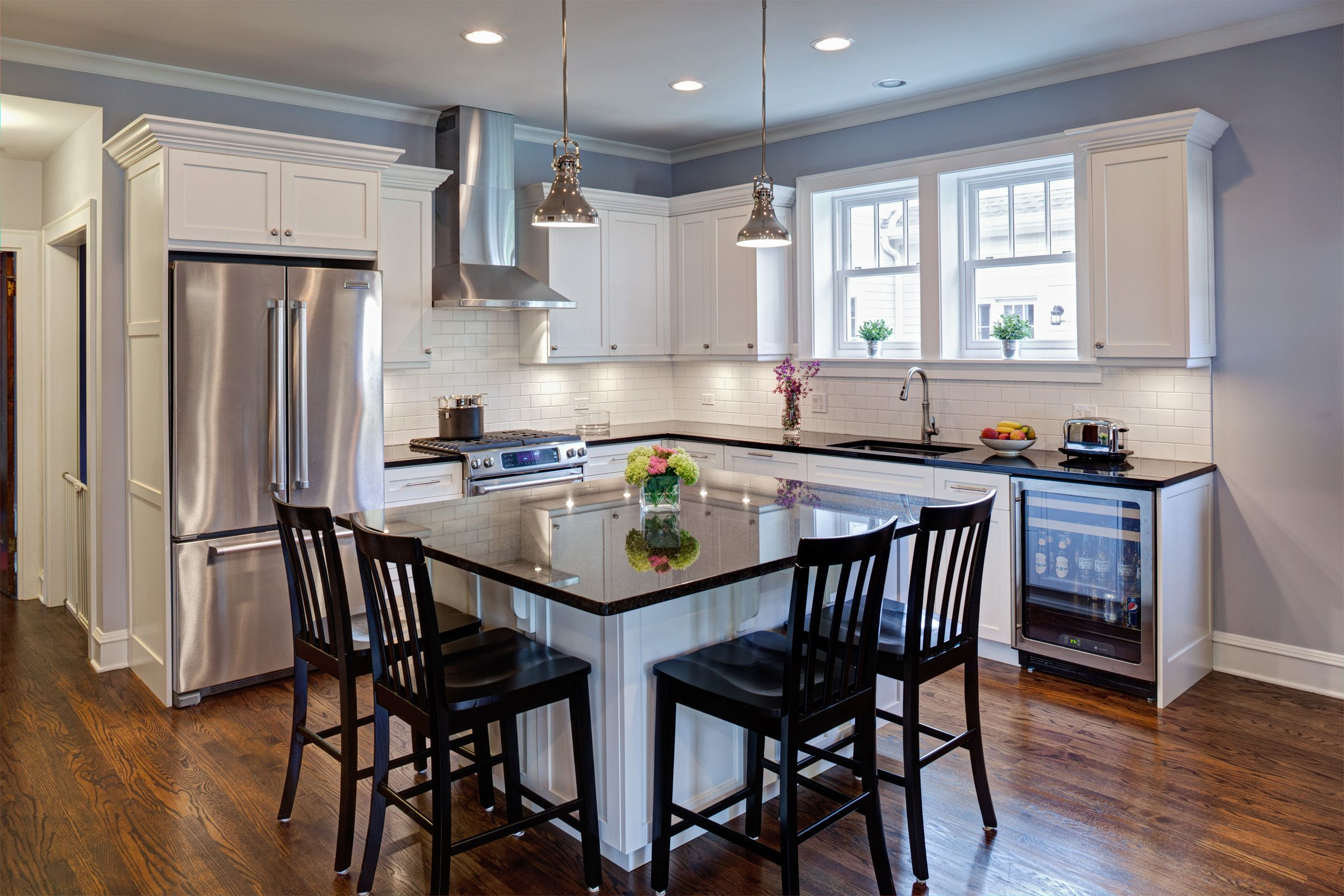 Evanston kitchen the island harbors functional amenities - Square kitchen island with seating ...